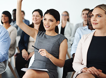 female advisor raising her hand in a group setting