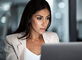 A businesswoman working at a computer